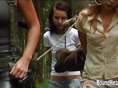 Two Young Girls With A Slave Huntress In New Home