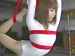Flexible Japanese slut gets tied up and violated by her captor