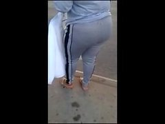 Candid booty milf waiting at bus stop