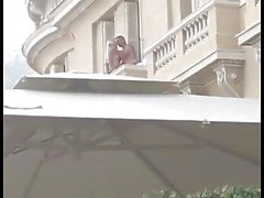 Man fucks blond slut over balcony