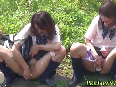 Asian teens squat and pee