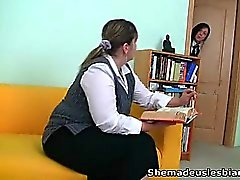 Dina and Kira suck and lick huge tits of their teacher.