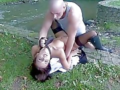 Busty brunette in black stockings gets fucked doggy style outdoor