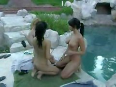 Three babes by the pool are rubbing and licking their pussies
