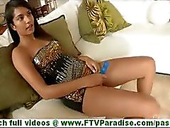 Bonaja attractive latina with big tits toying pussy with blue dildo on couch