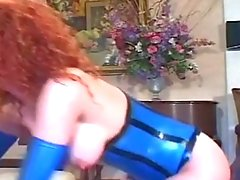 Redhead fucking in fencenet stockings and latex