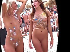 Beautiful girls with exquisite painted bodies in nude beach