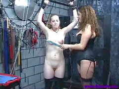 Sex slave gets bound by leather cuffs and mistress gives nipple